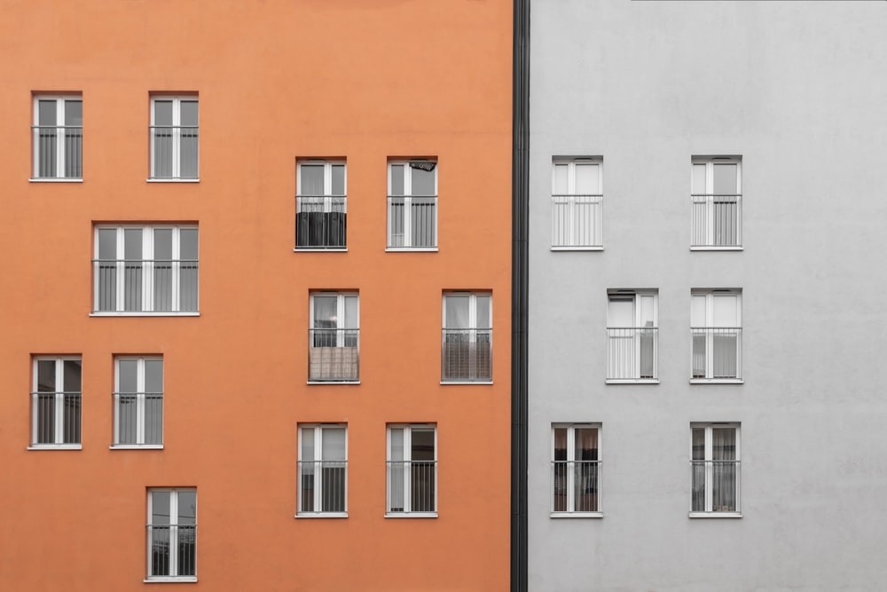 white and orange painted buildings windows
