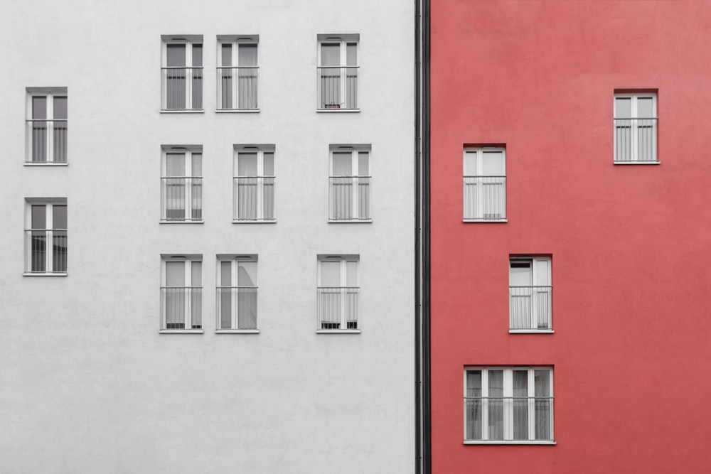 pink and white painted concrete buildings