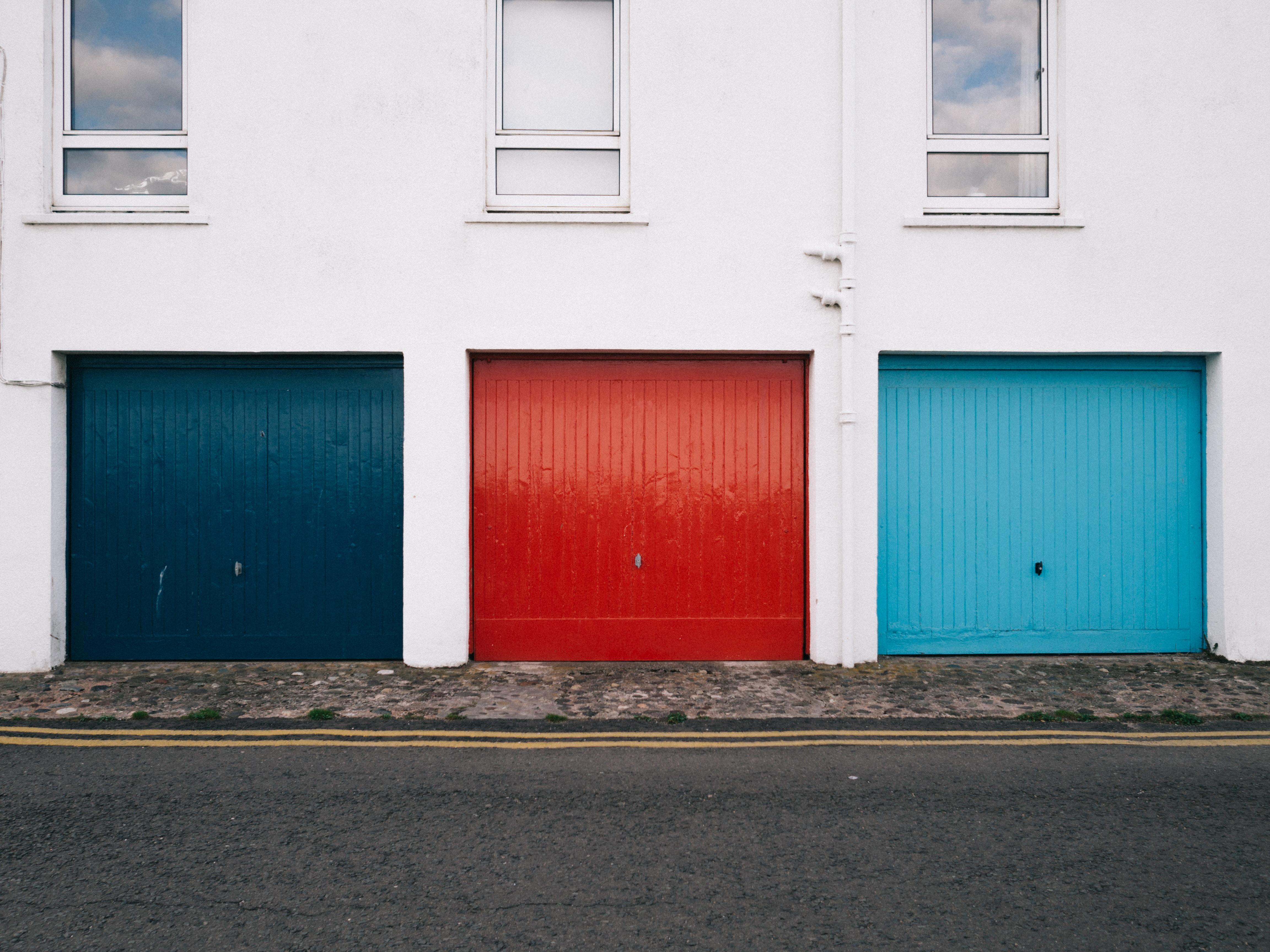 blue shutter door beside rroad