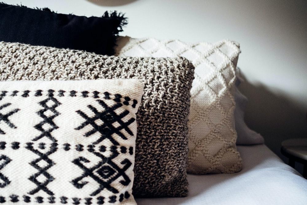 three gray throw pillows