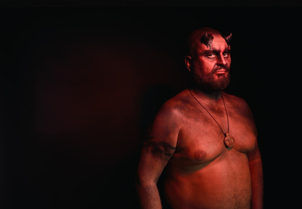 man wearing demon costume