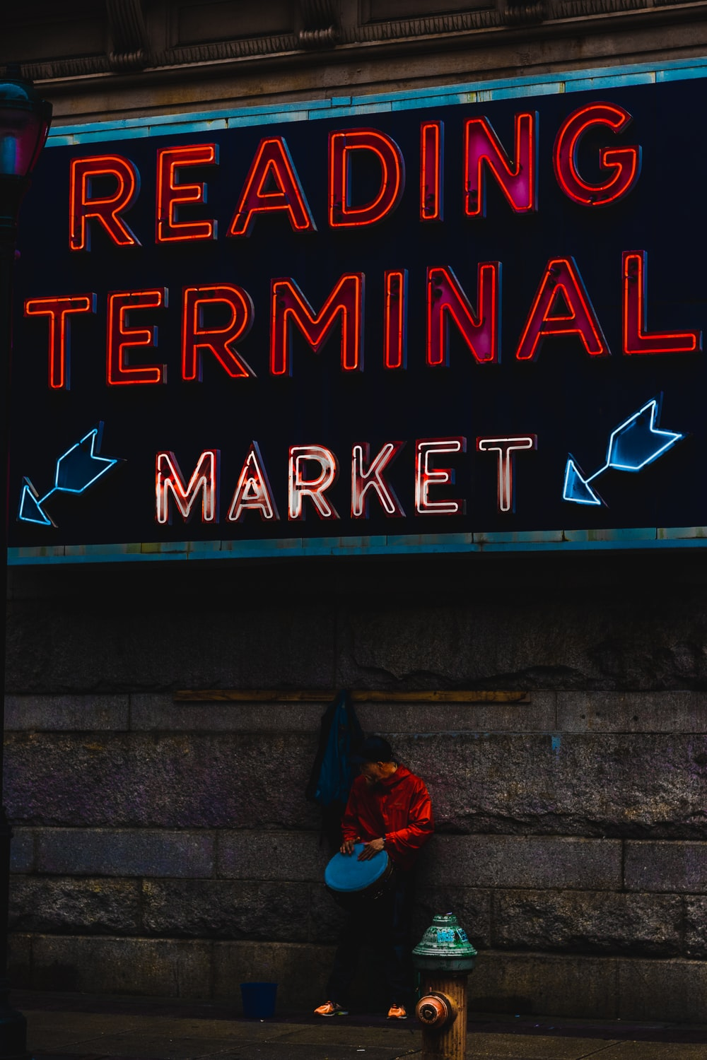 person standing near red and white reading terminal signage