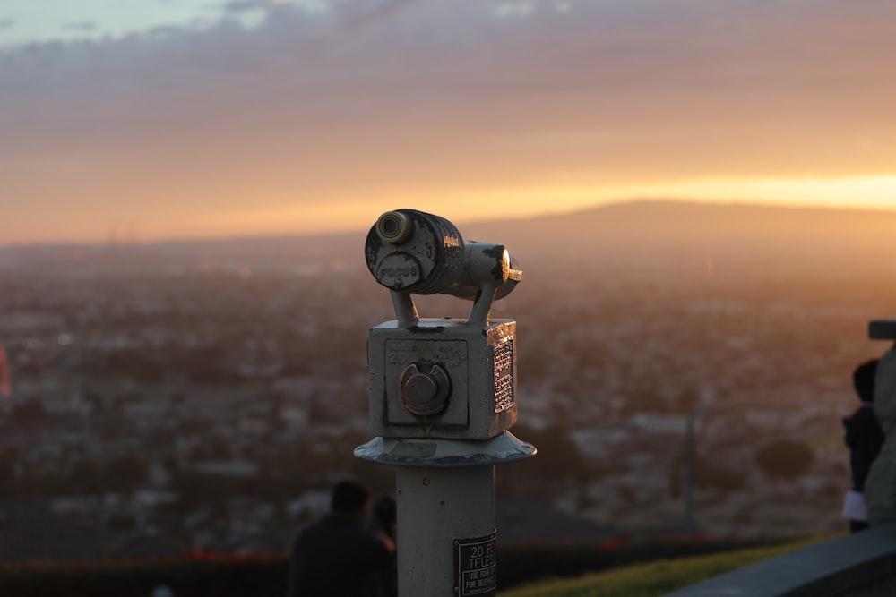 gray metal telescope during orange sunset