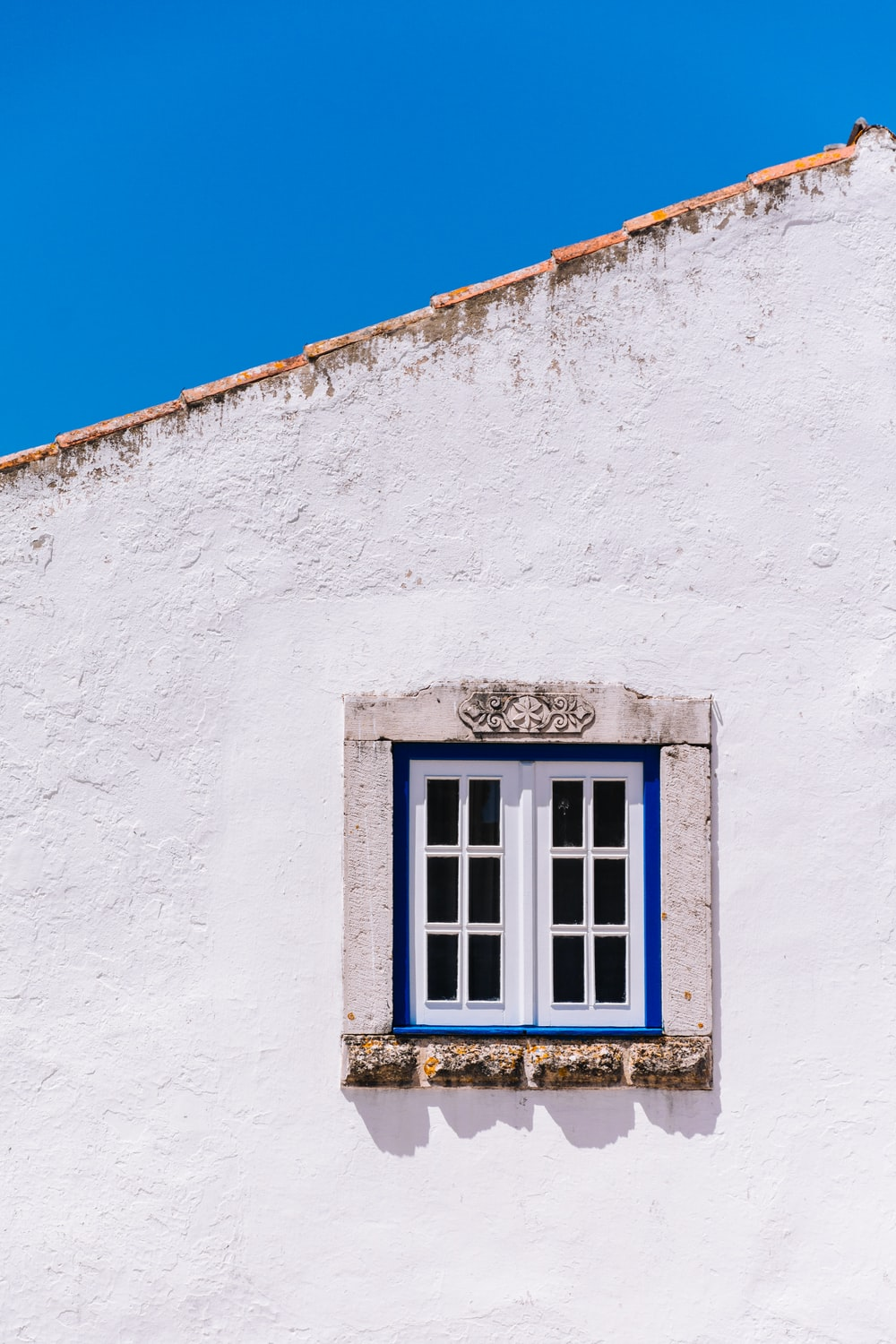 house with white wooden window