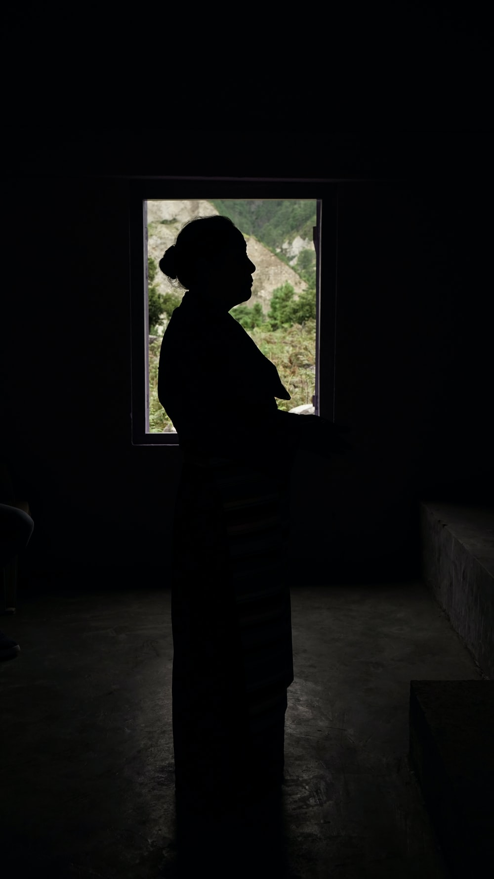 silhouette of woman standing inside room