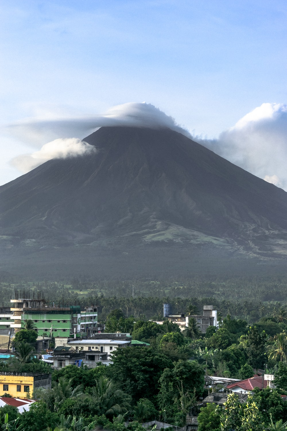 white cloud on cone shaped volcano