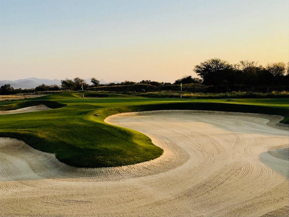 golf field under clear blue sky