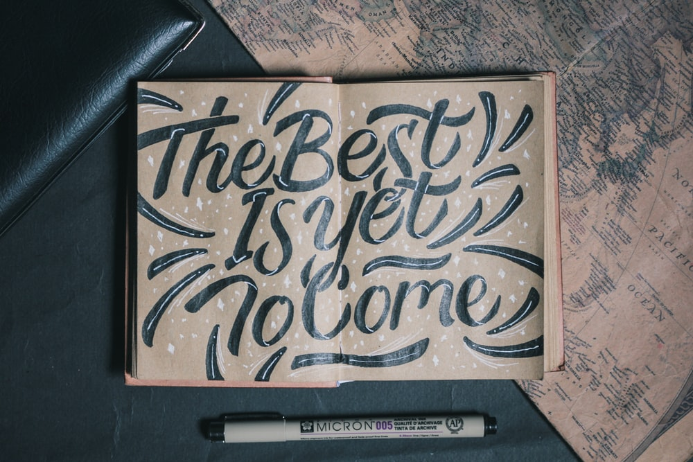 the best is yet to come-printed board beside white pen