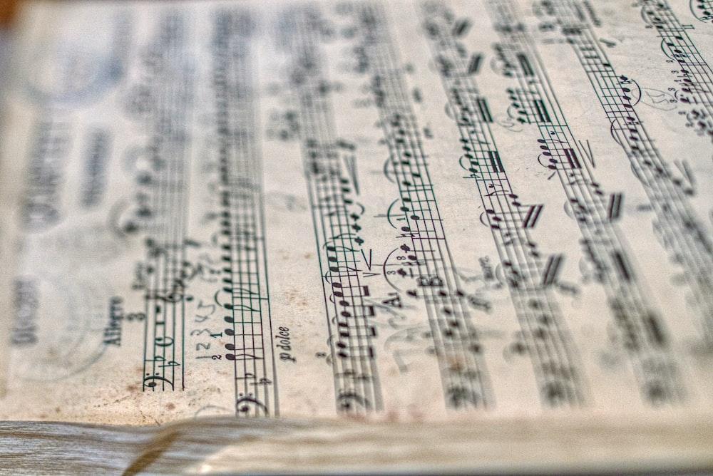 selective focus photography of 2 flats music sheet