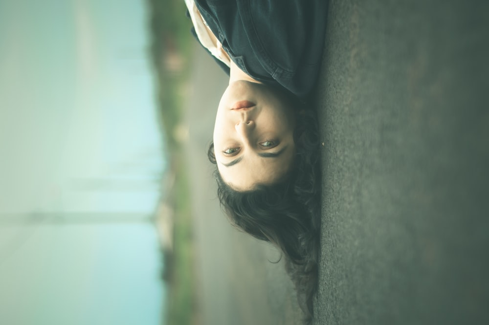 woman lying on road
