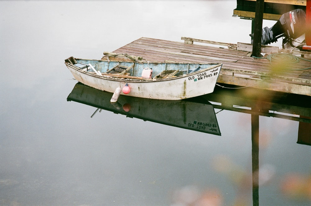 white boat near dock