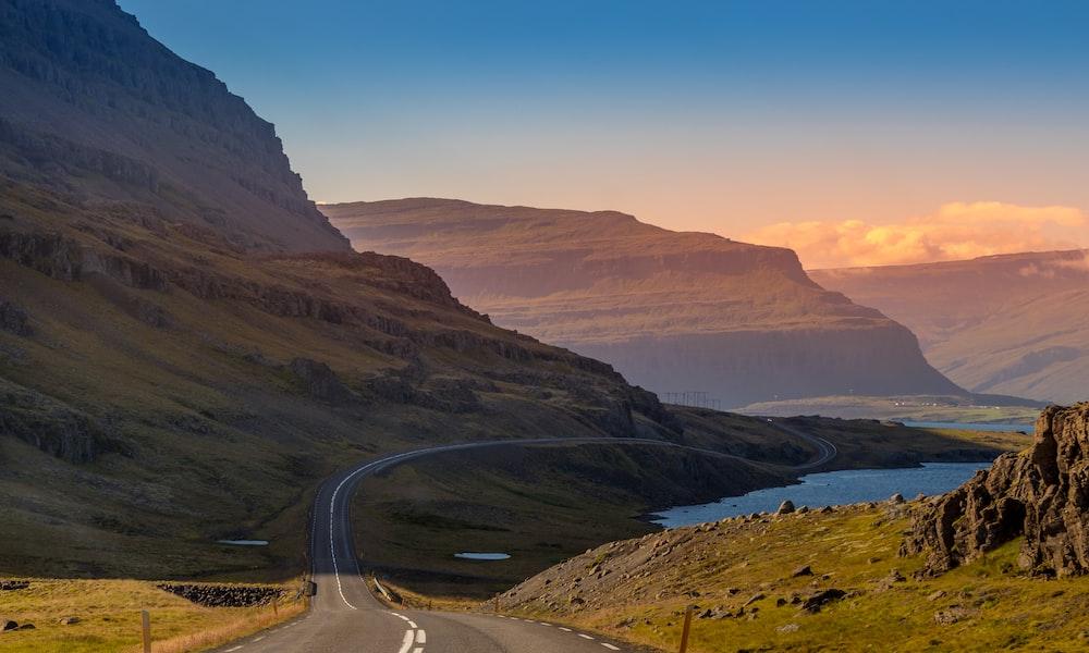 asphalt road near mountain