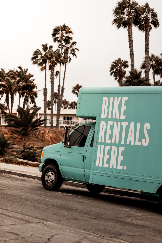 teal Bike Rentals Here. utility van