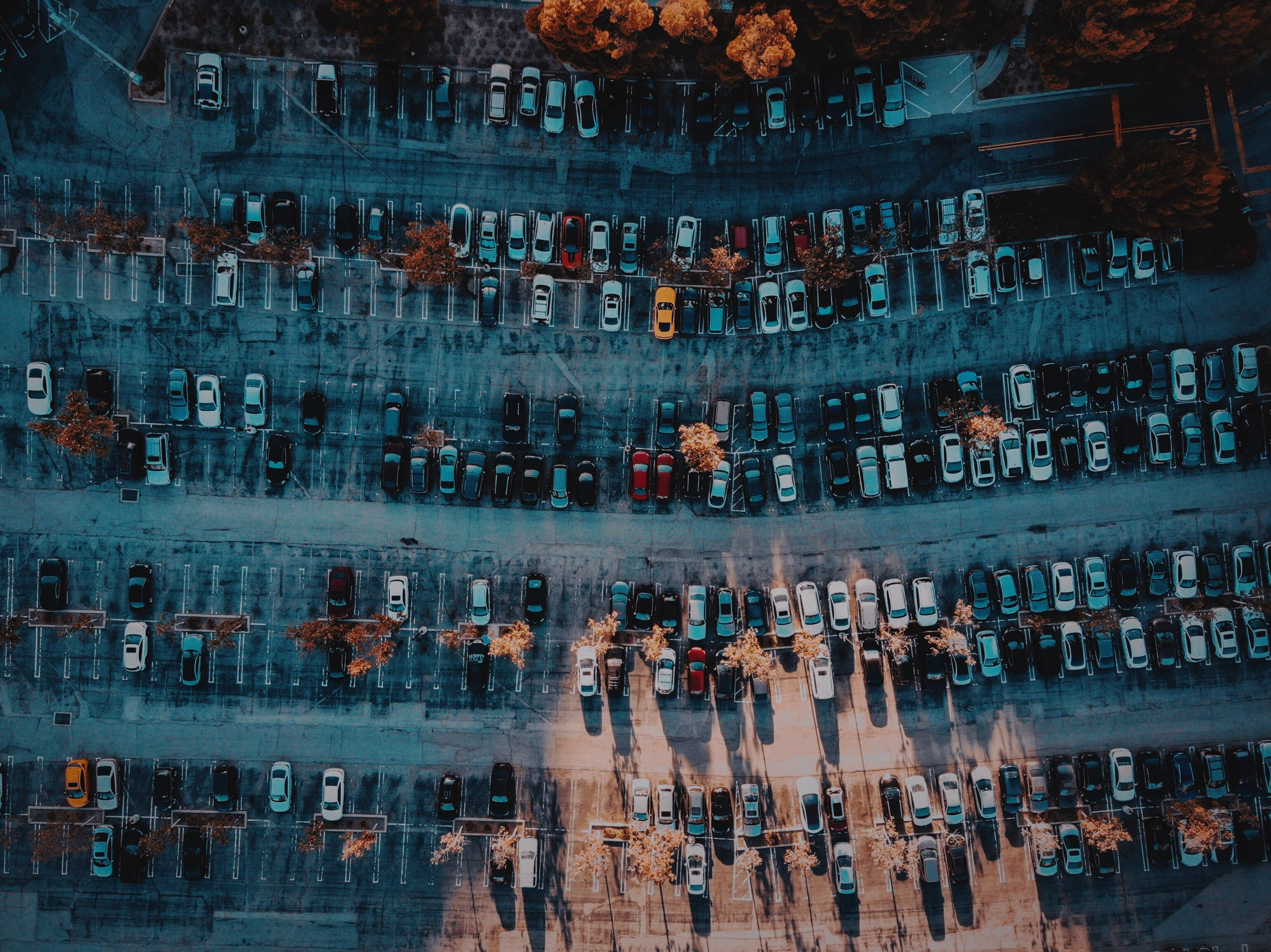 assorted-color parked vehicle lot on parking area in aerial photography