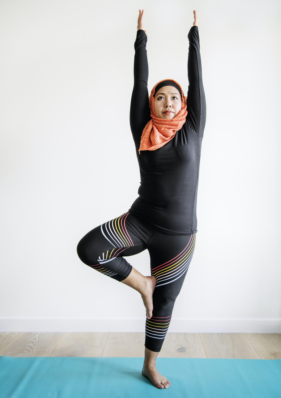 woman performing yoga on mat