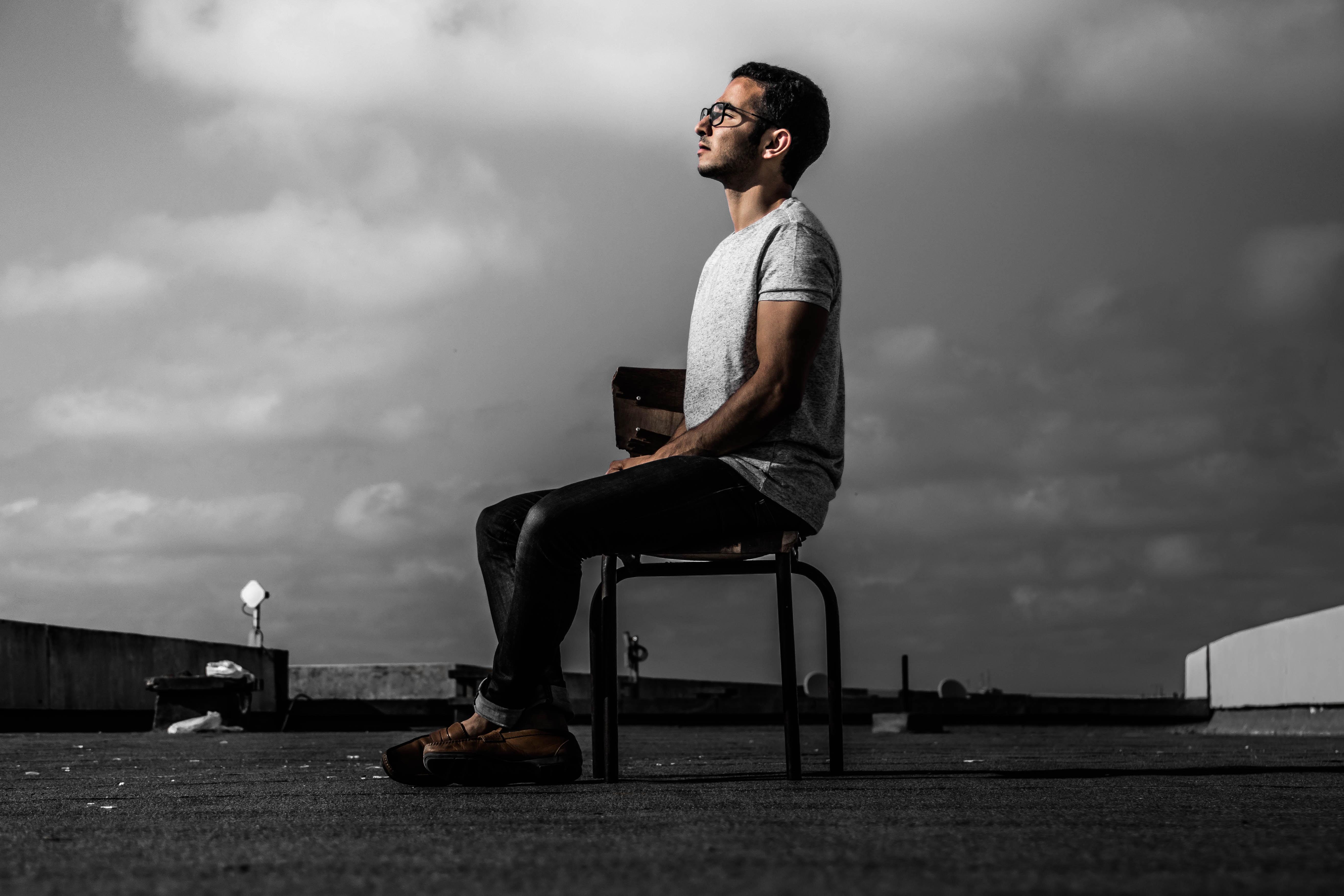 man sitting on chair during daytime