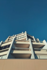 low-angle photography of beige and white concrete building