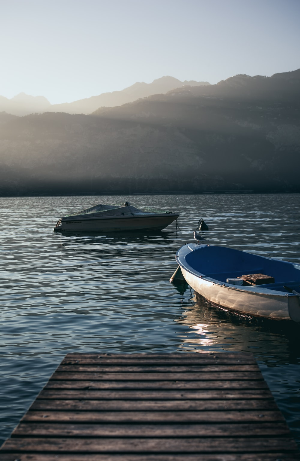 two gray boats on body of water