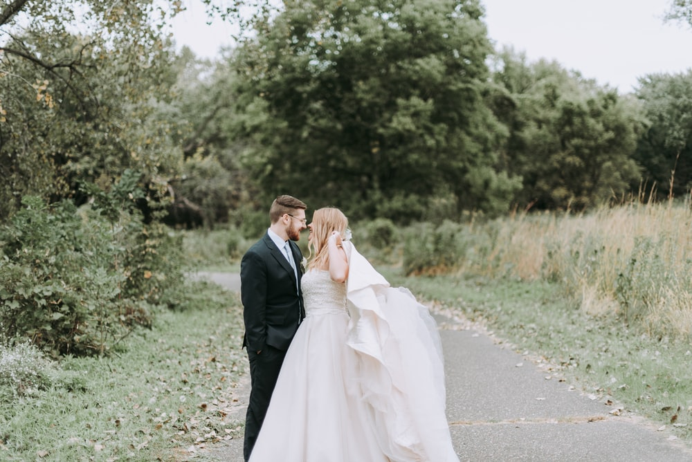 groom and bride on pavement