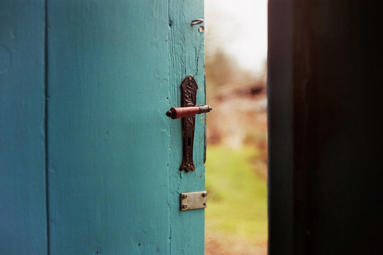 Blue door opening to new possibilities
