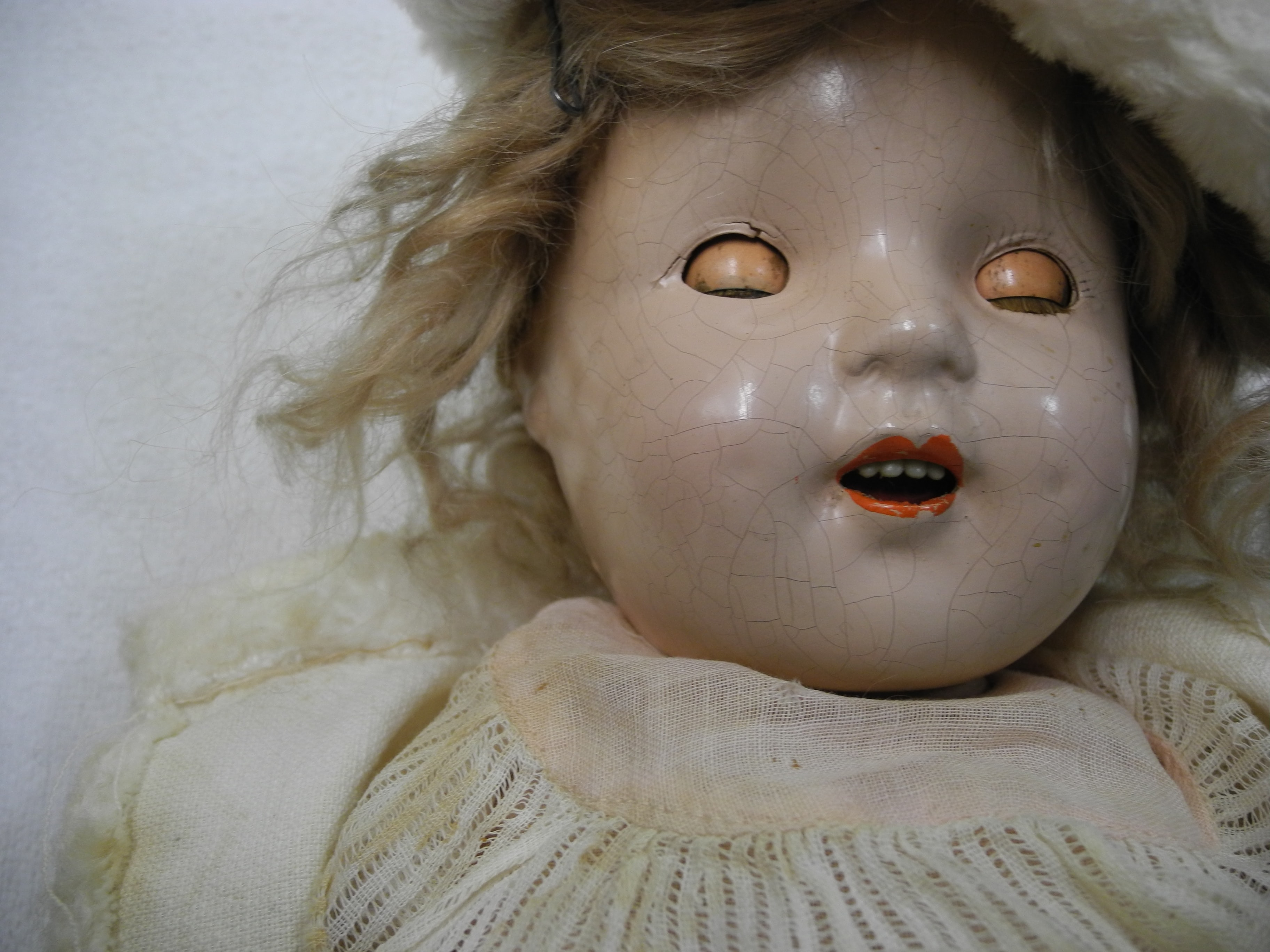 doll in white dress