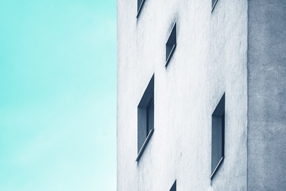 low-angle shot photography of concrete buildings