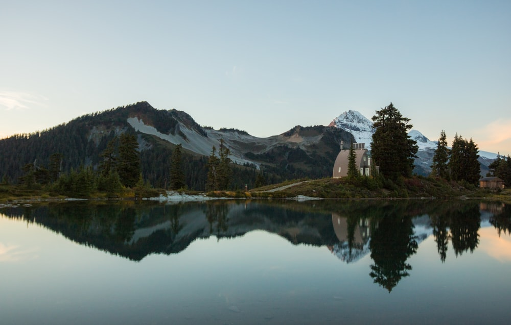 panoramic photography of mountain near lake during daytime