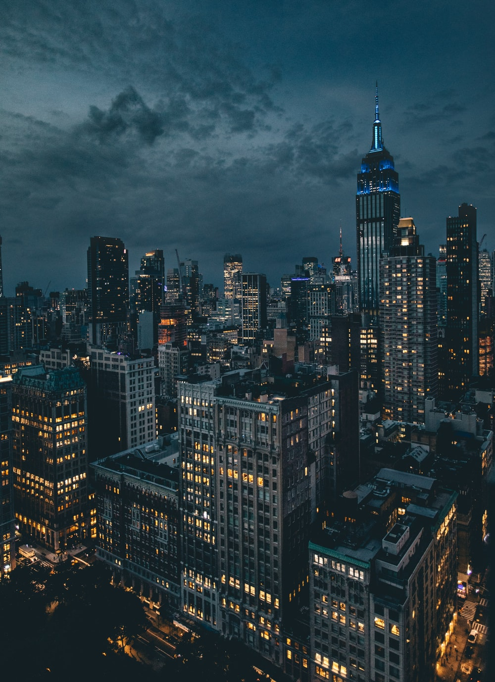 aerial photography of high rise building at nighttime \