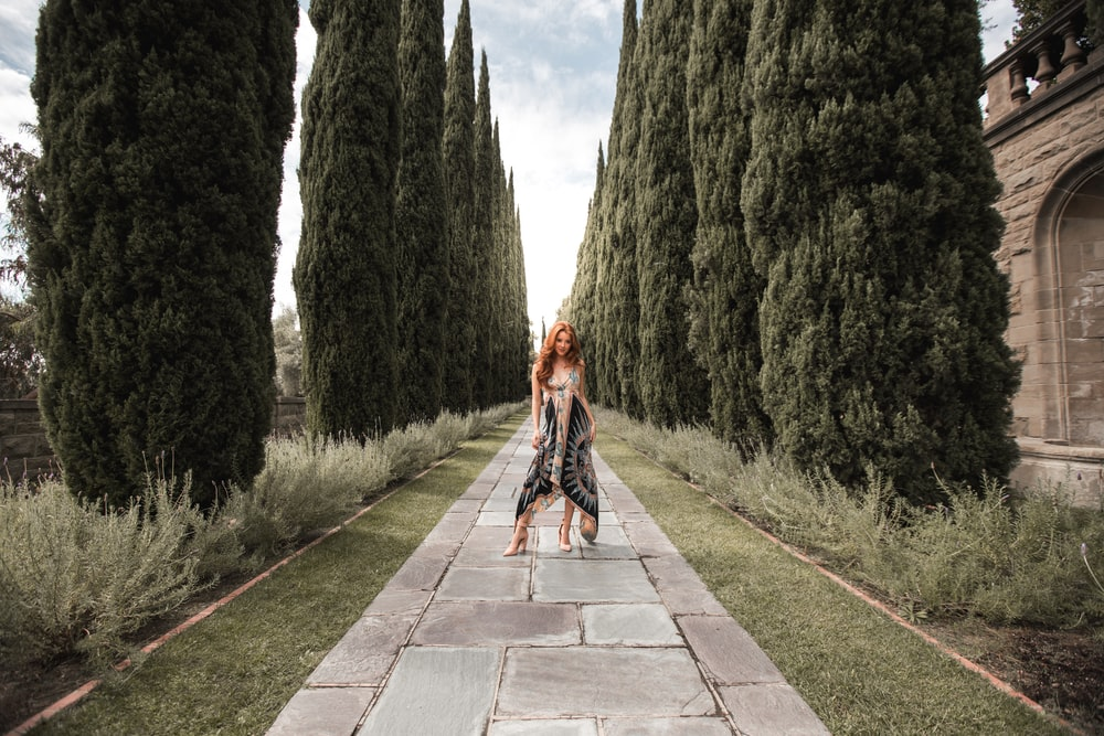 woman standing gray concrete pathway