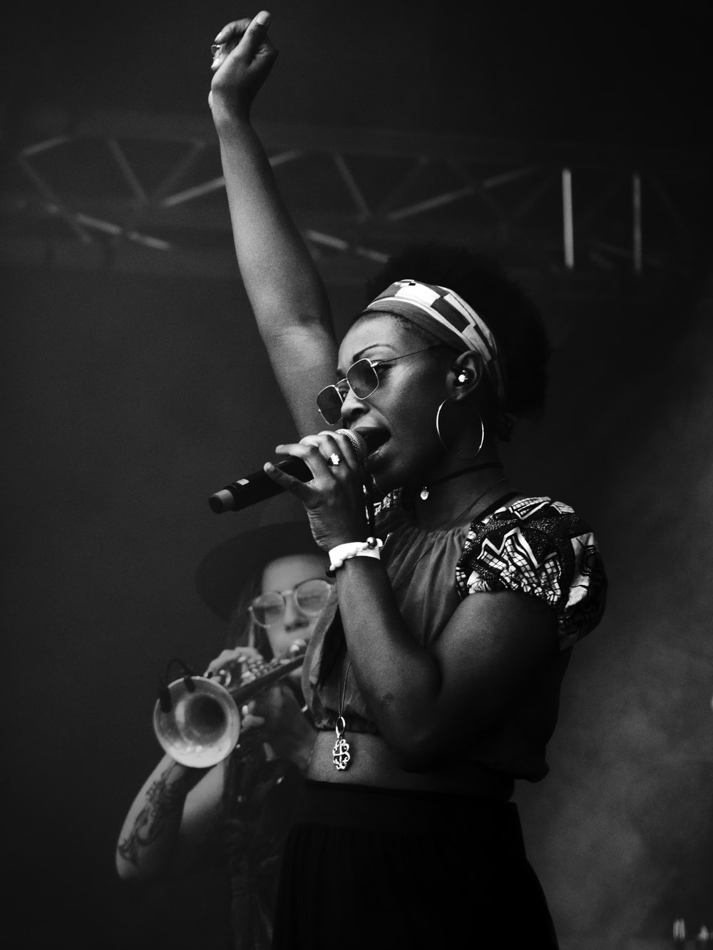 grayscale photography of woman holding microphone