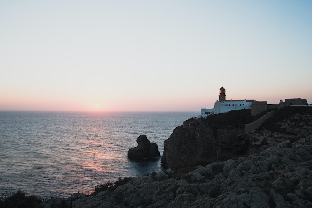 lighthouse by the sea during golden hour