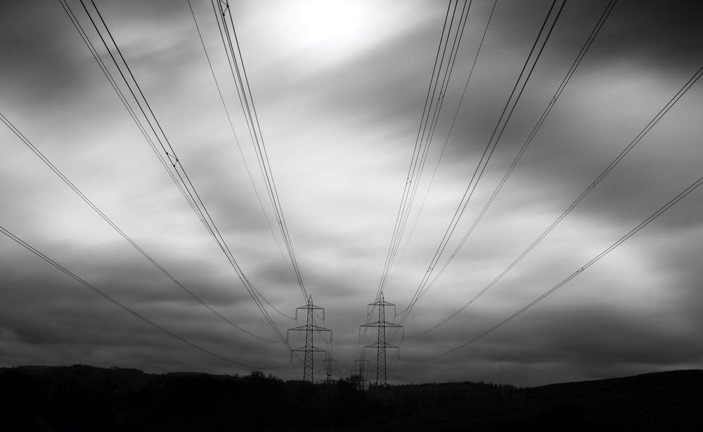 grayscale photo of transmission post