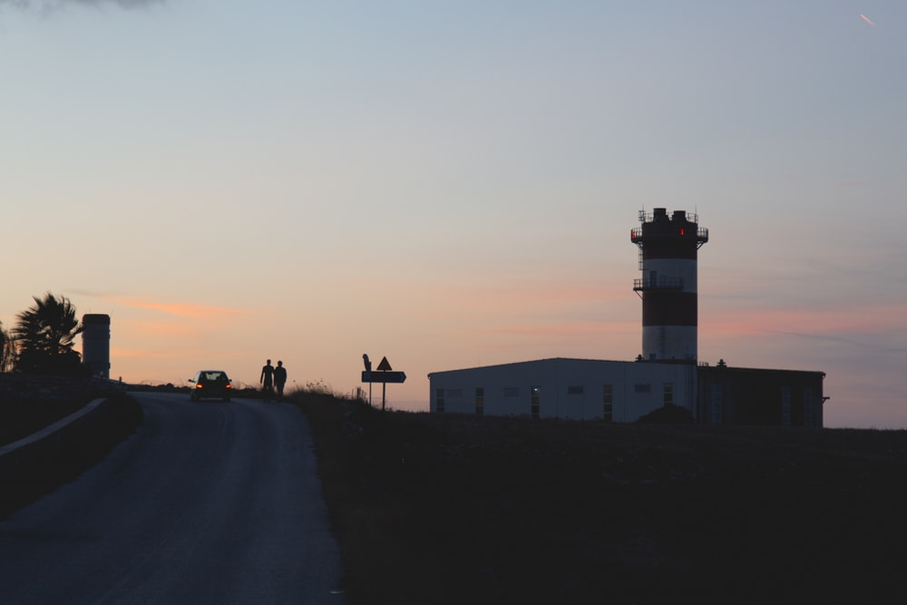 asphalt road near tower