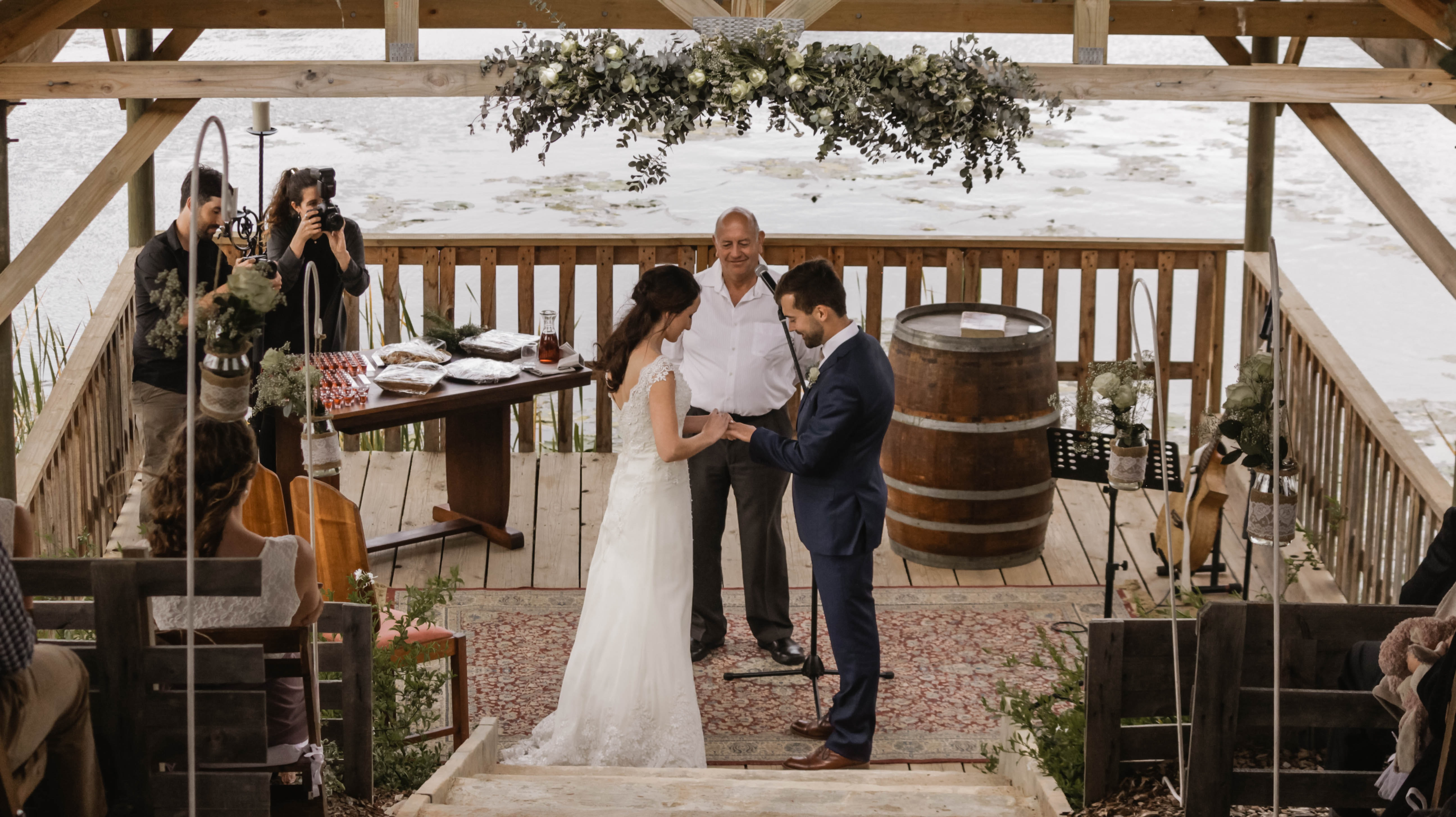 bride and groom standing on cottage