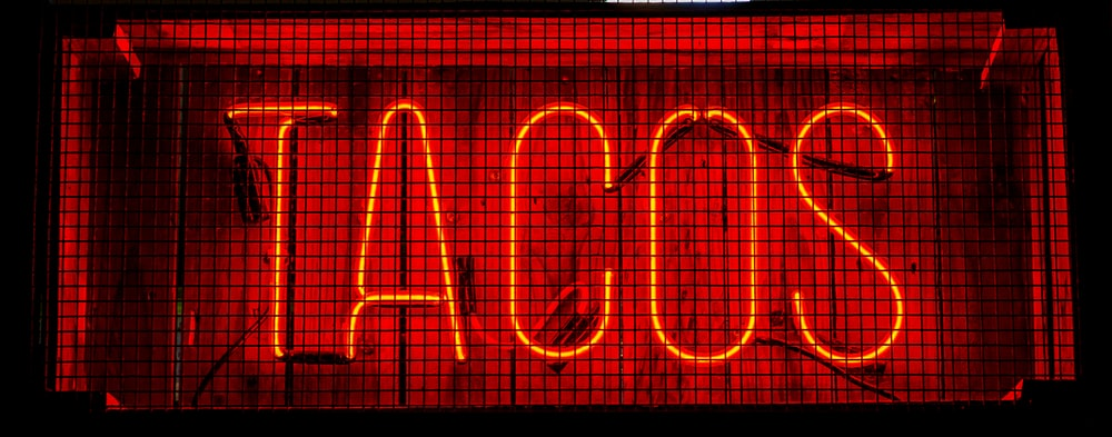 red TACOS LED signage