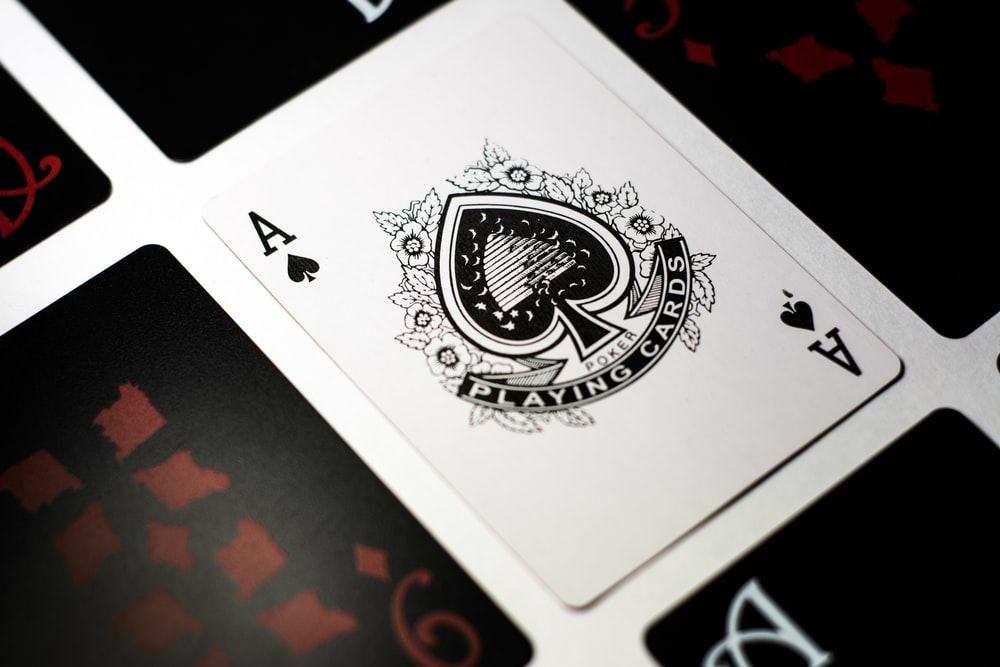 spade playing card on white surface