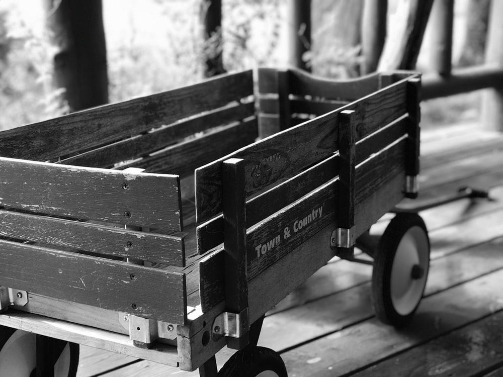 grayscale photography of wooden wagon
