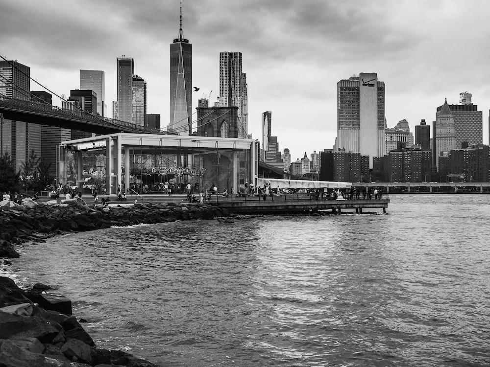 grayscale photo of city seaside
