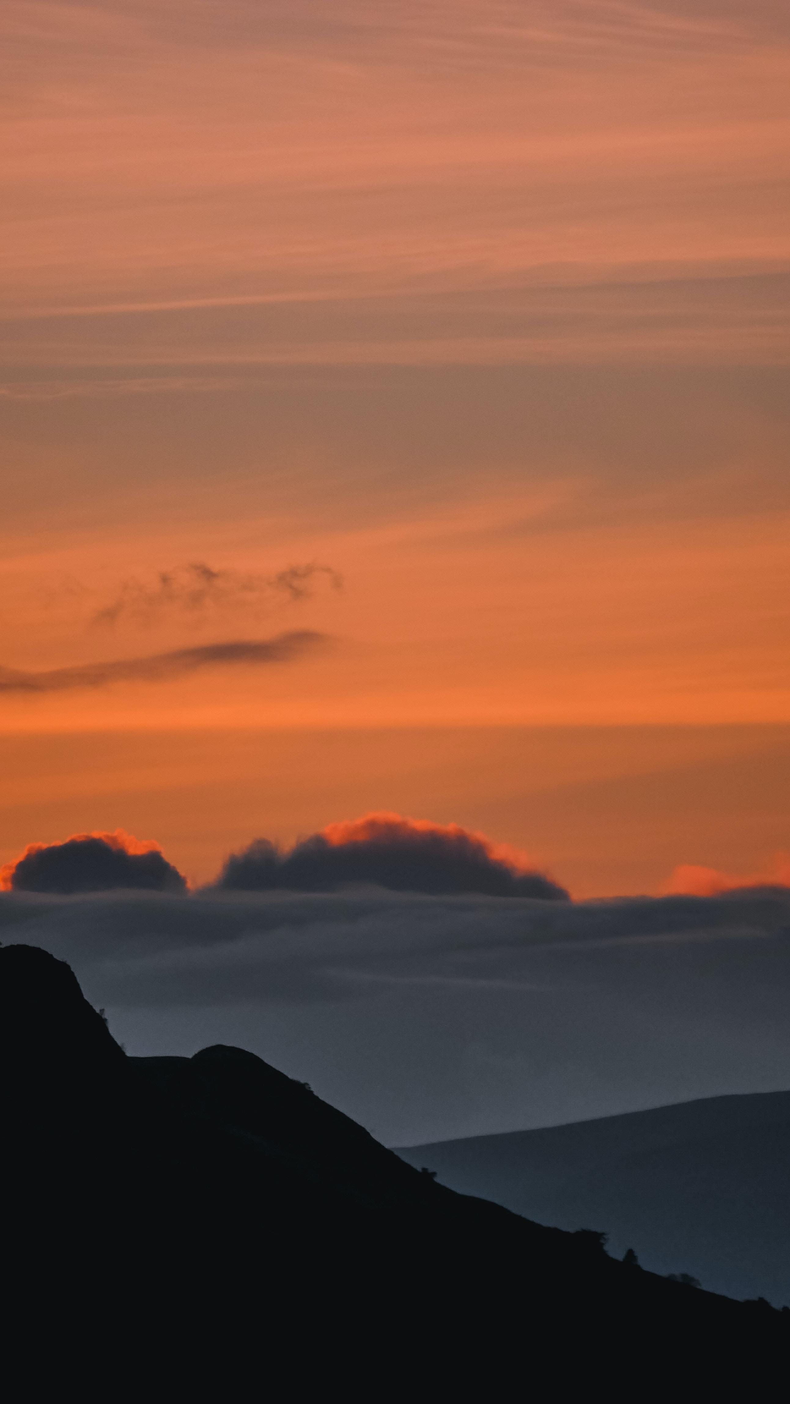 black mountain under white sky