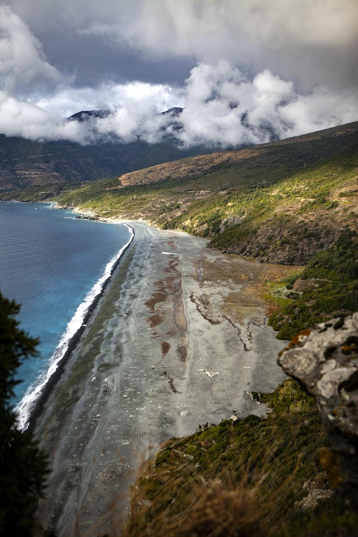 bird's eye view photography of water near coast