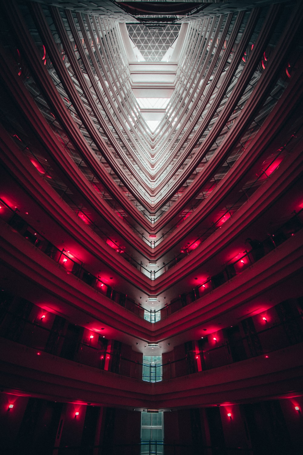 low-angled photography of building interior with red lights