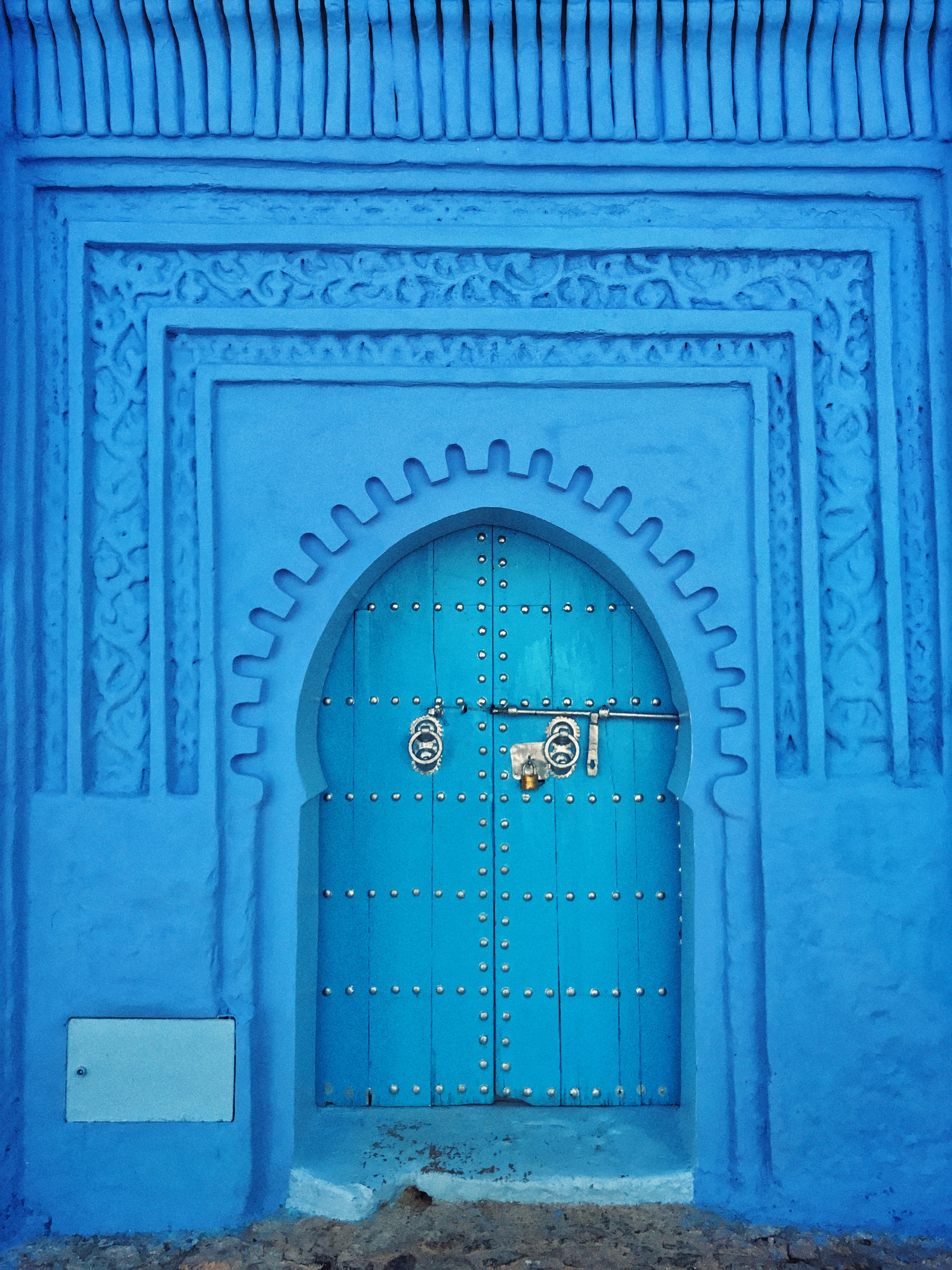 blue painted wall and door at daytime