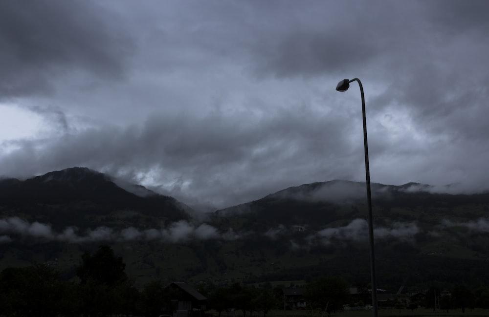 black post under cloudy sky