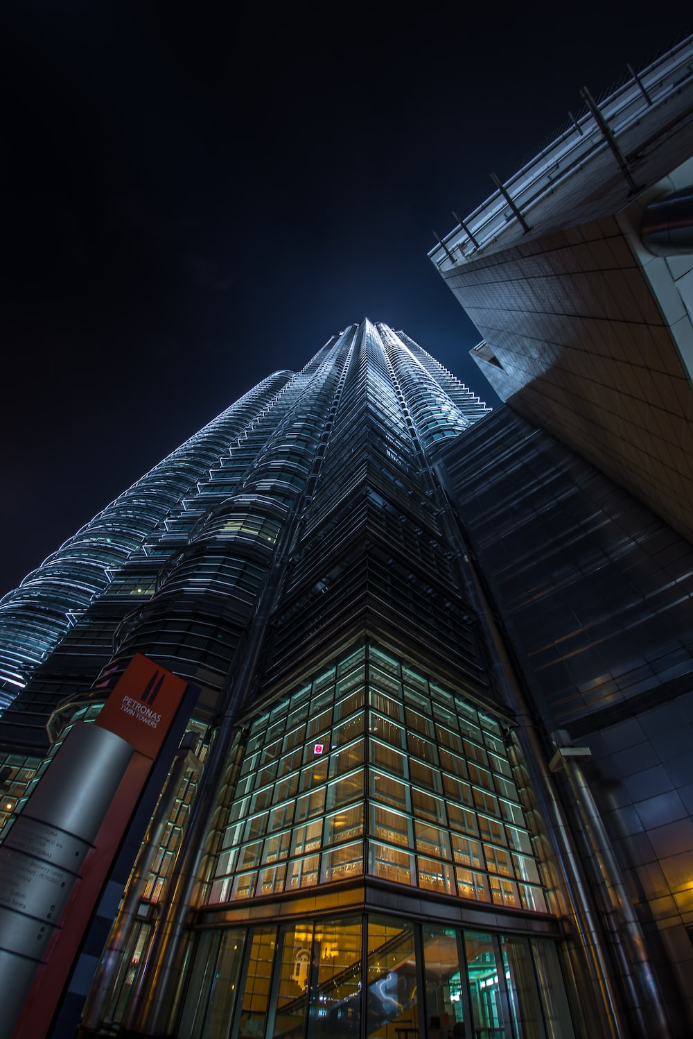 worms-eye view photo of building during nighttime