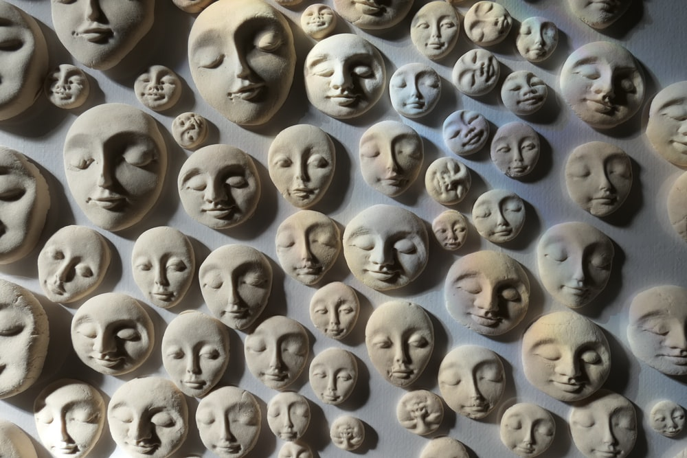 embossed face wall decor