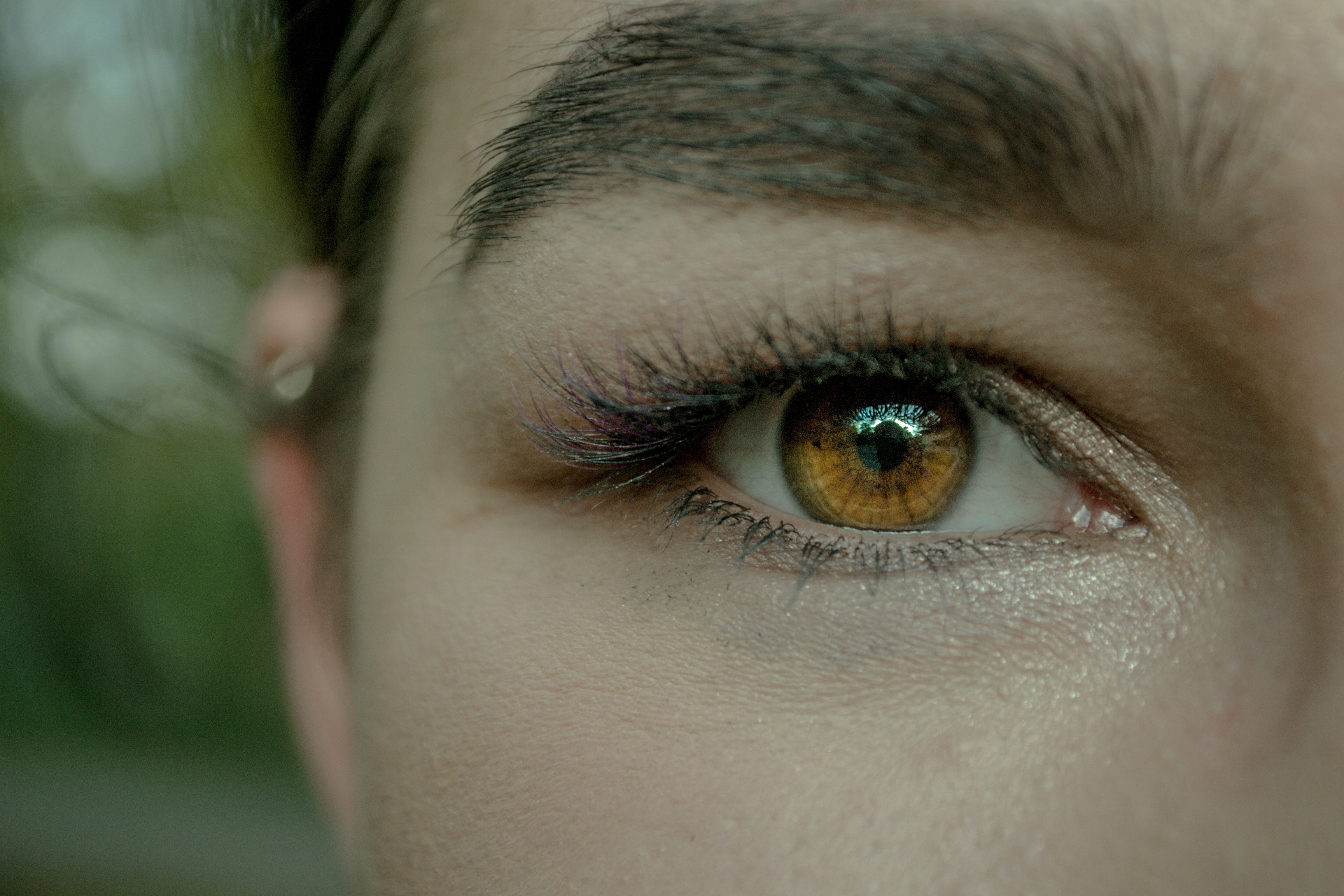 close-up photography of the eye of the woman