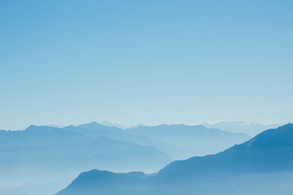 mountain range under clear blue sky