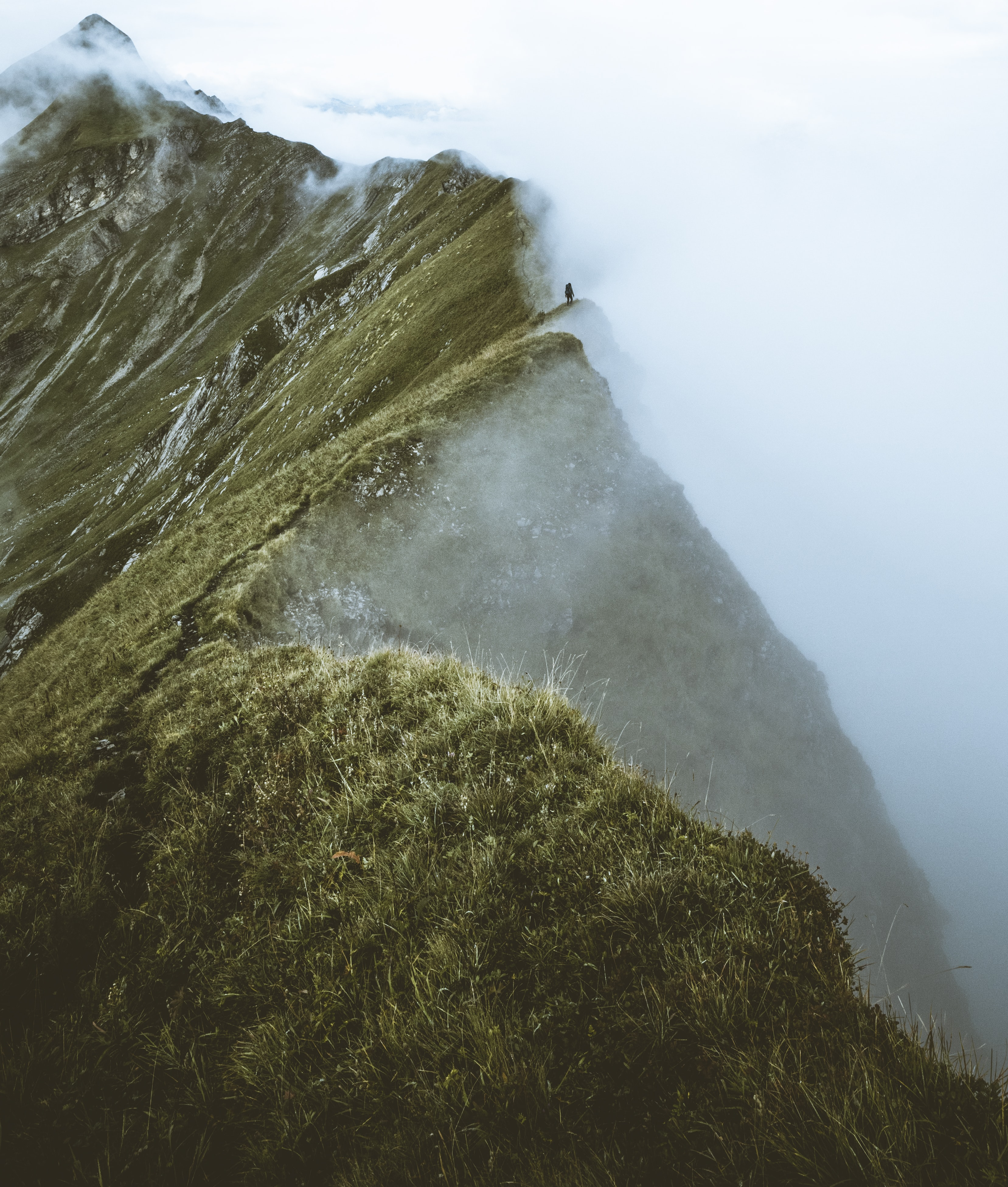 bird's-eye view of mountain covered with fog