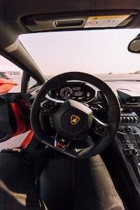 black Lamborghini car steering wheel