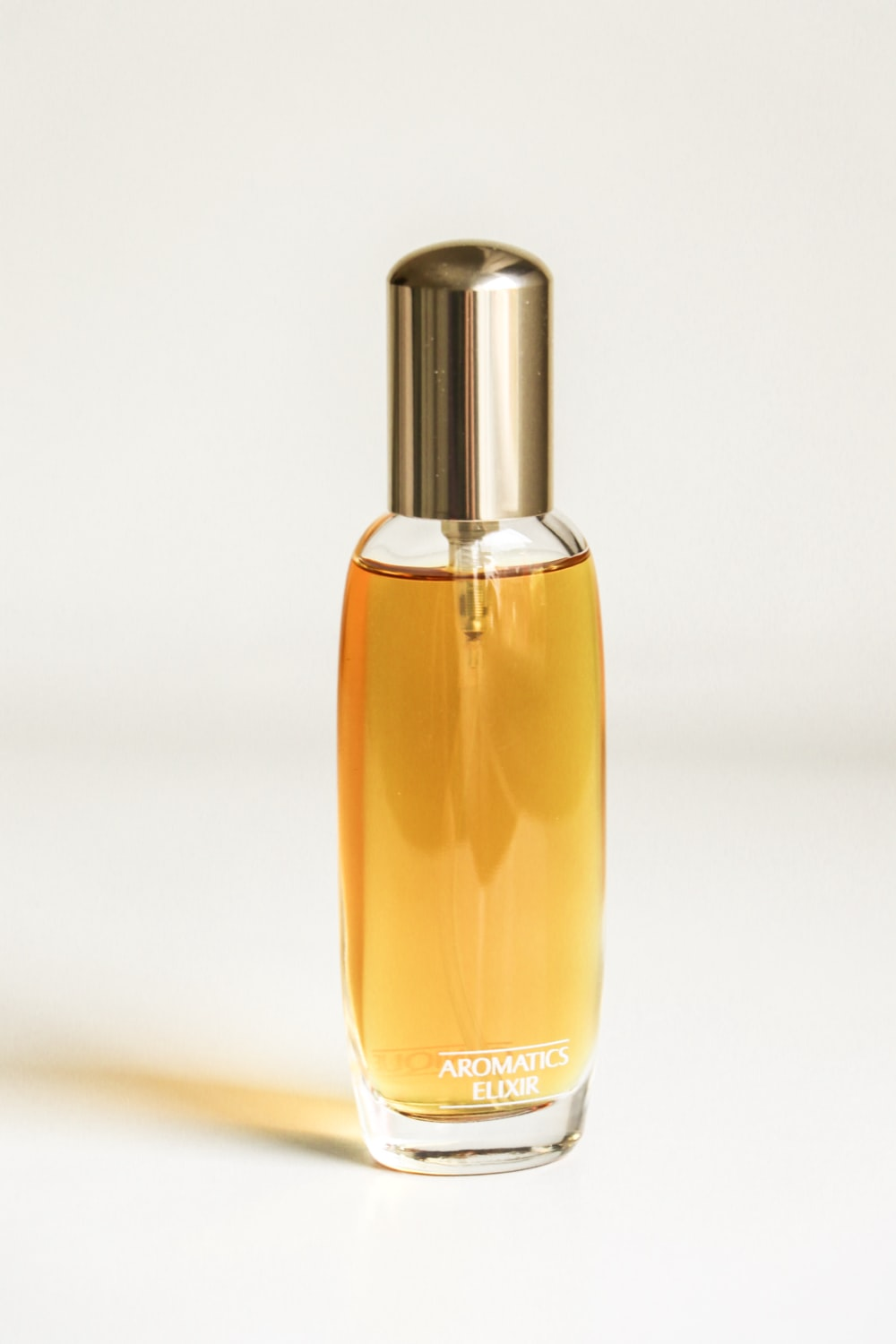 yellow and silver perfume bottle